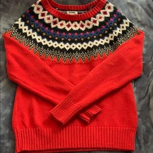 Red Christmas sweater.